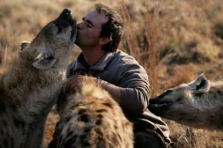 Kevin Richardson kisses hyena. Image by Kevin Richardson, 2007